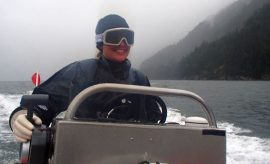 Research coordinator Jessica Schultz at the helm of the Vancouver Aquarium's dive research boat.