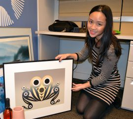 "Samantha showcases a NATA silent auction item: ""Tadpole Serigraph"" by local artist Susan Point."