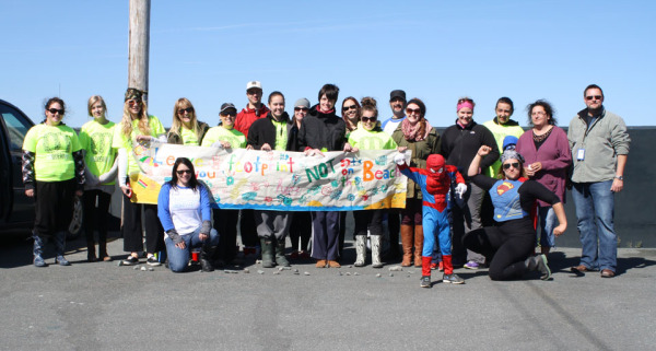 Local Spiderman joins volunteers in cleaning up St Philip's Shoreline in St. John's. © Stephanie Nicholl / WWF-Canada.