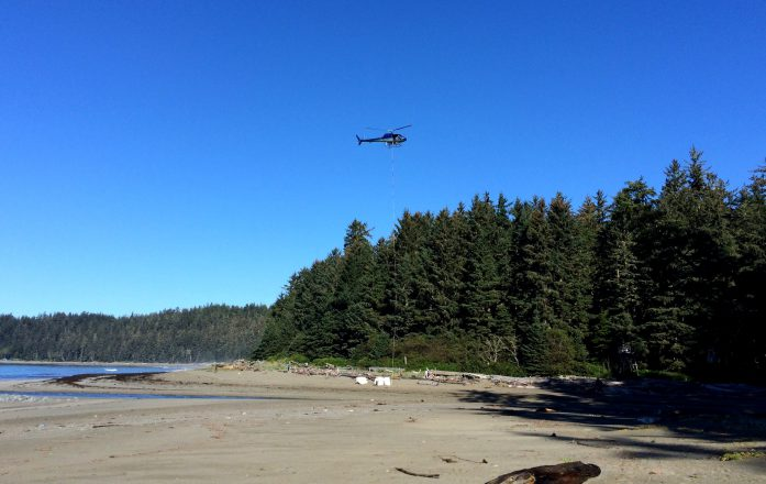 A helicopter removes marine debris from the West Coast Trail