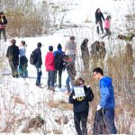 1,000 Students Participate in Snowy Spring Cleanup
