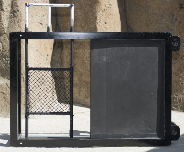 The frame used in the net-detection research. (Net on left, opaque screen on right - neither light nor sound can get through it)