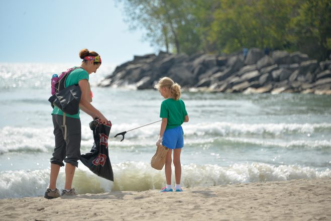 Participants of the 2015 Great Canadian Shoreline Cleanup finding litter near the water's edge in Toronto, O.N. Photo credit: Canadian Press.