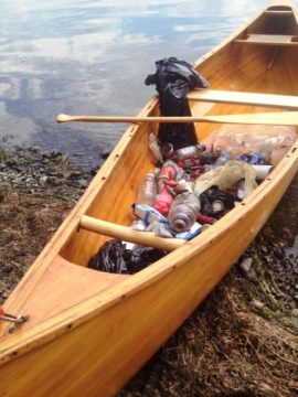 The HMS WasteKnot, Chris' beautiful hand-built canoe he uses to collect litter along the St. Lawrence.