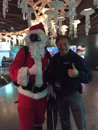 Sonny gets festive with Scuba Claus.