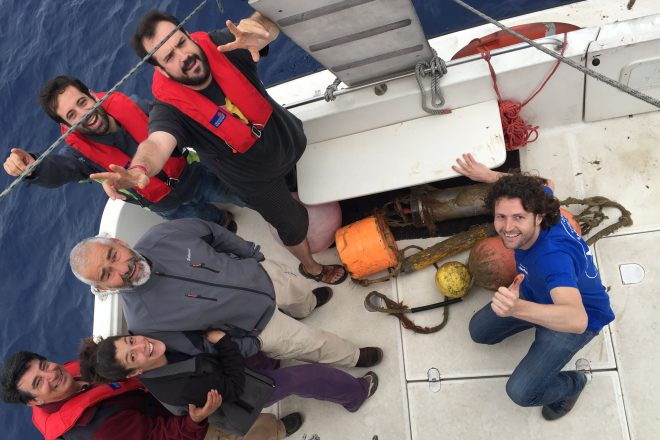 The research team and boat crew on a mission to retrieve the hydrophone.
