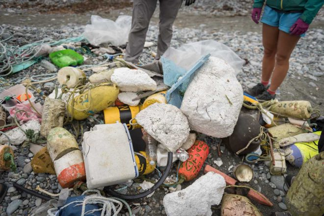 A typical assortment of marine debris, including buoys, styrofoam, shoes and plastic bottles.